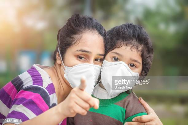 mother and child wear facemask during corona virus and flu outbreak. virus and illness protection - nose mask stock pictures, royalty-free photos & images
