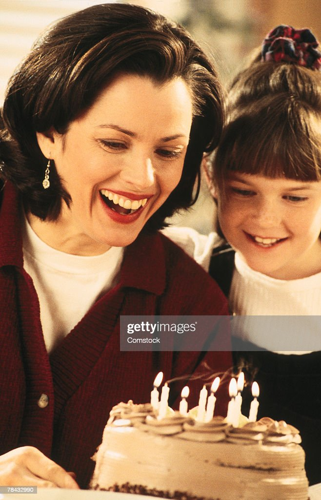 Mother and child with birthday cake : Stockfoto