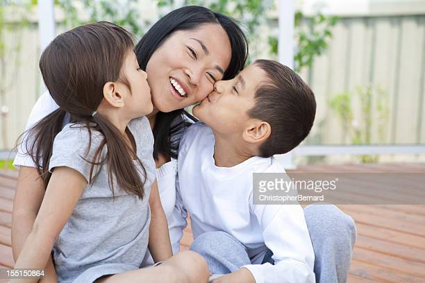 mother and children being playful - vietnamese ethnicity stock pictures, royalty-free photos & images