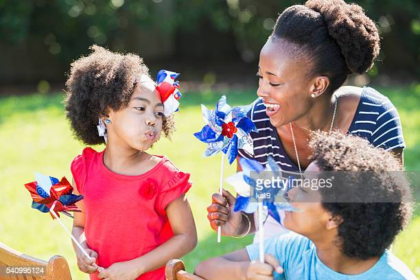 Mother and children celebrating 4th of July