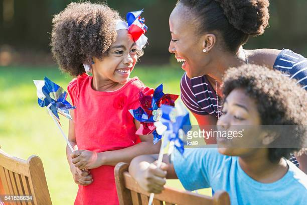 mother and children celebrating 4th of july - war memorial holiday stock pictures, royalty-free photos & images