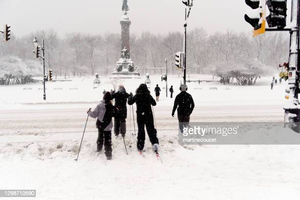 "mother and children crossing street on cross-country sky in montreal snow storm. - ""martine doucet"" or martinedoucet stock pictures, royalty-free photos & images"