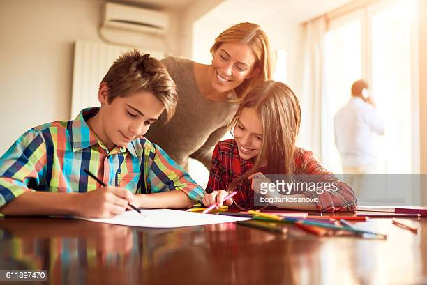 mother and children doing homework - homeschool ストックフォトと画像