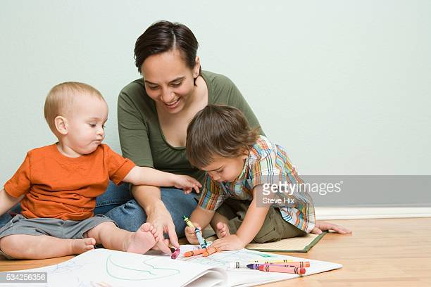 mother and children drawing in coloring books - art and craft stock pictures, royalty-free photos & images