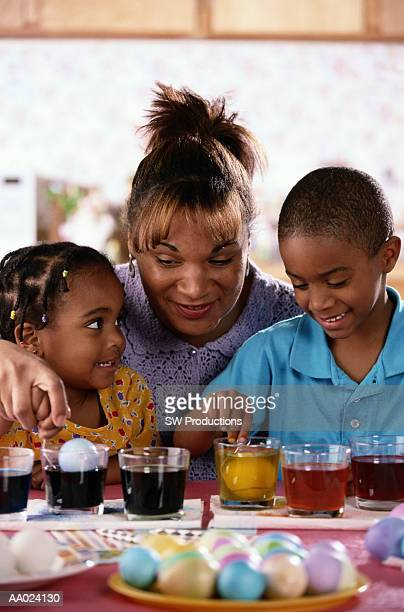 Mother and Children Dyeing Easter Eggs
