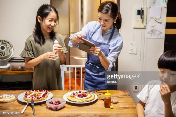 mother and children get along and make pancakes - women whipping men stock pictures, royalty-free photos & images
