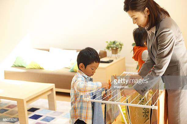 Mother and children hanging out the laundry