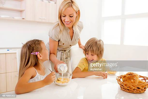Mother and children having a breakfast in the morning.