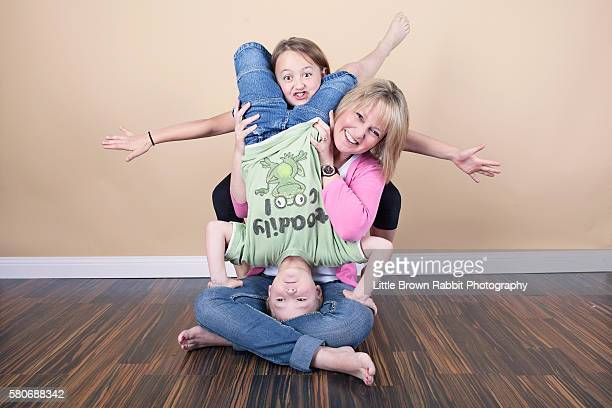 A Mother and Children Having Fun for the Camera