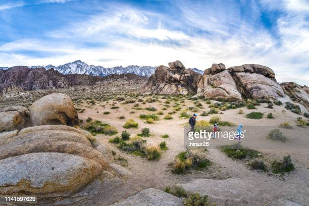 mother and children hiking - alabama hills stock photos and pictures
