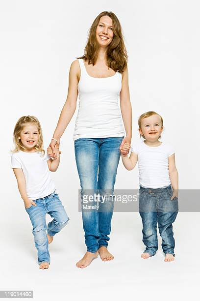 Mother and children holding hands