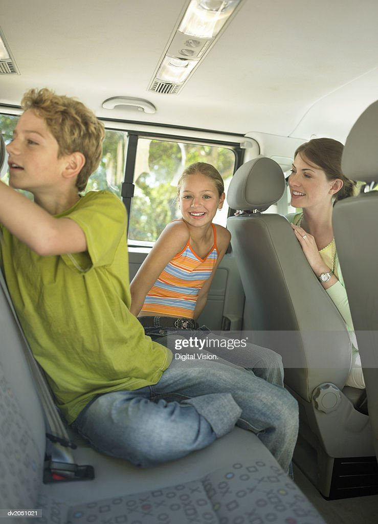 Mother and Children in an SUV Car : Stock Photo
