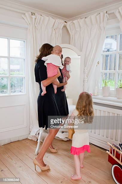 Mother and children in front of mirror