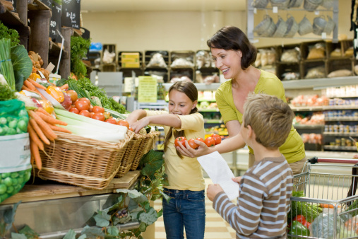 Mother and children in fruit and vegetable section of supermarket - gettyimageskorea