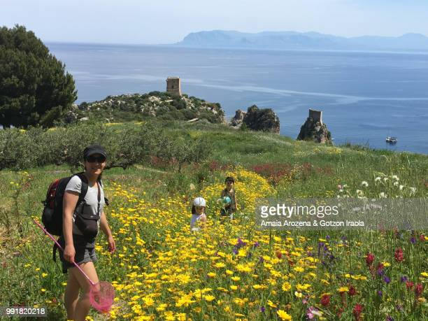 Mother and children in Scopello. Sicily, Italy.