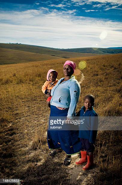 Mother and children in the grasslands outside of Transkei.