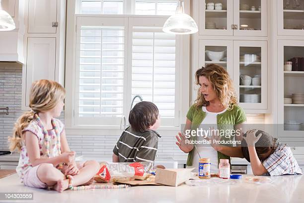 mother and children in the kitchen