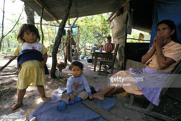 Mother and children living in a refugee camp in southern Mexico just across the border from their native Guatamala. They left their homeland to...