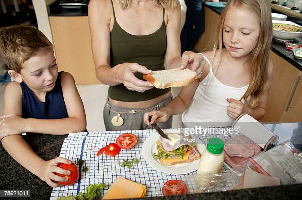 Mother and Children Making Sandwich