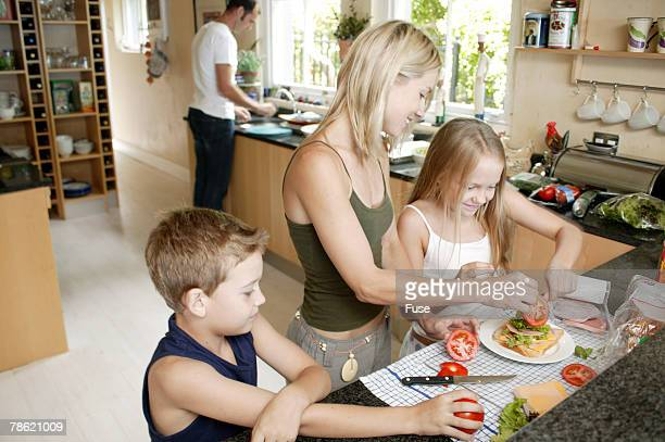 Mother and Children Making Sandwiches