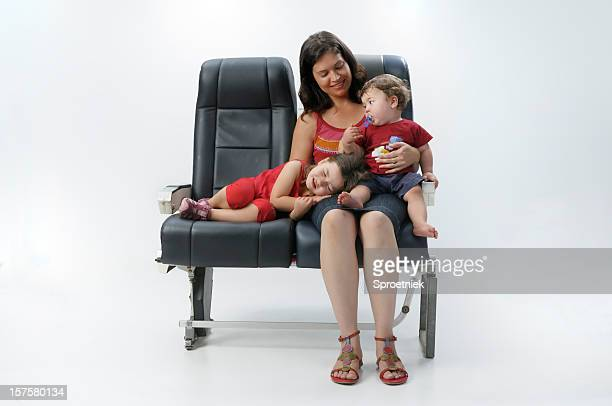 Mother and children on aircraft