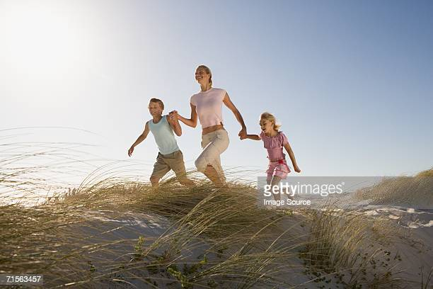 Mother and children on sand dunes