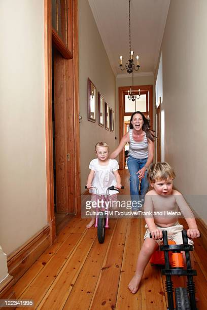 Mother and children playing in hallway