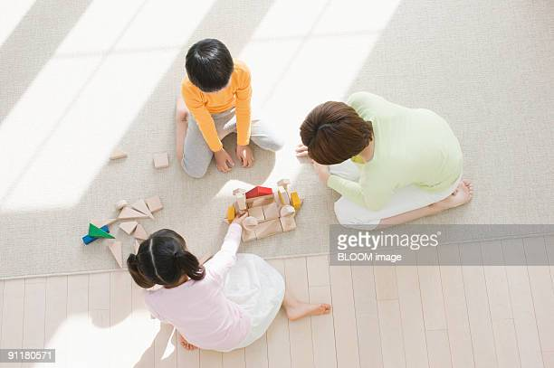 mother and children playing with blocks - japanese girls hot stock photos and pictures