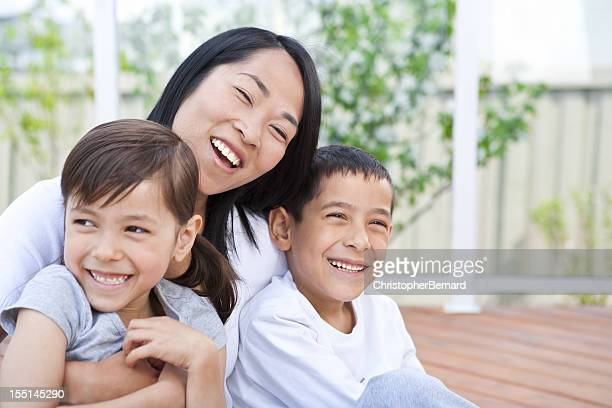 mother and children sitting on deck - vietnamese ethnicity stock pictures, royalty-free photos & images