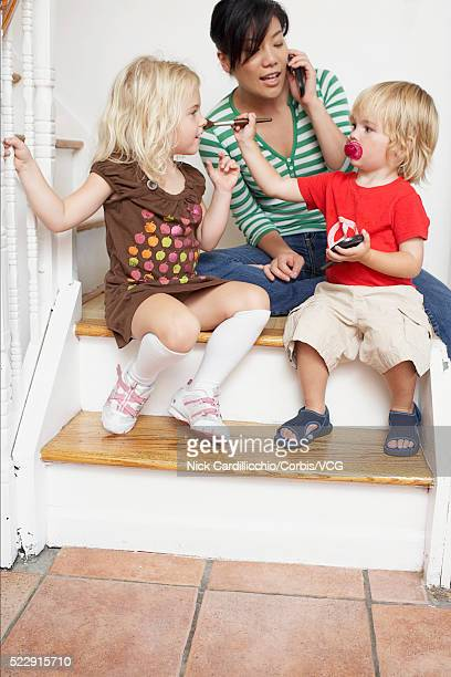 Mother and children sitting on the stairs