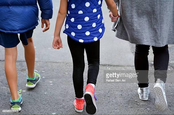 mother and children walks down the street together - rafael ben ari fotografías e imágenes de stock