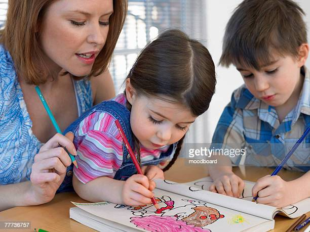 Mother and Children with Coloring Book