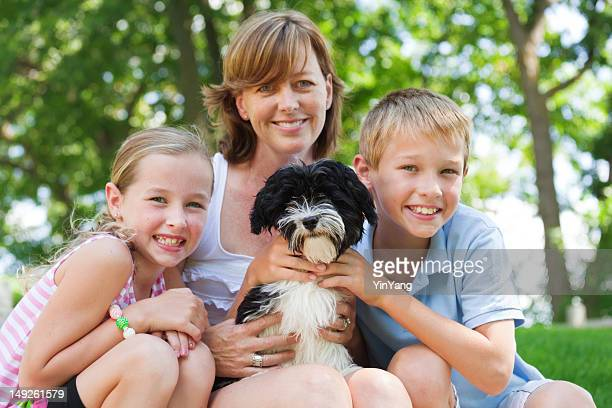 Mother and Children with Family Pet Dog