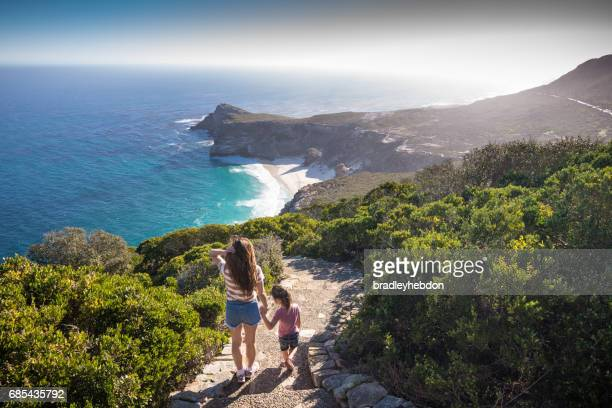mother and daugher at cape point enjoying the view - cape town stock pictures, royalty-free photos & images