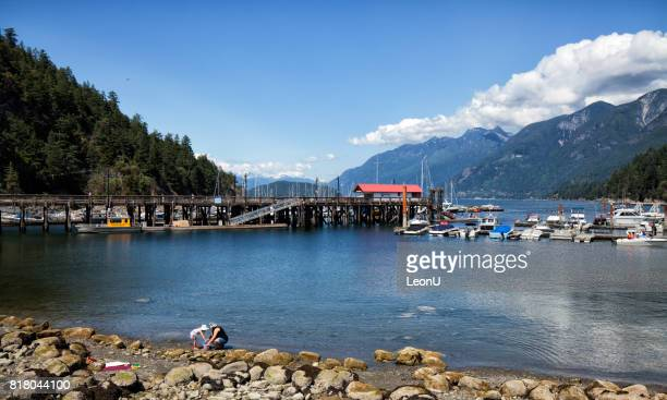 mother and daugher playing at beach at horseshoe bay, west vancouver, canada - ferry stock pictures, royalty-free photos & images