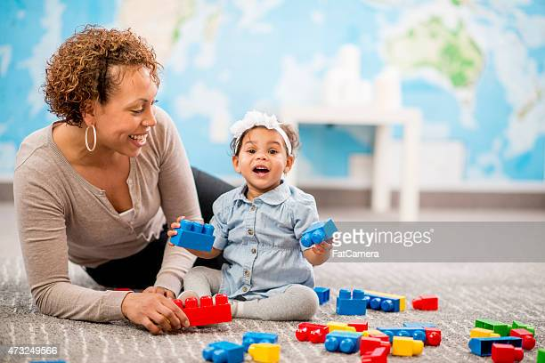 Mother and Daugher Playing at Daycare