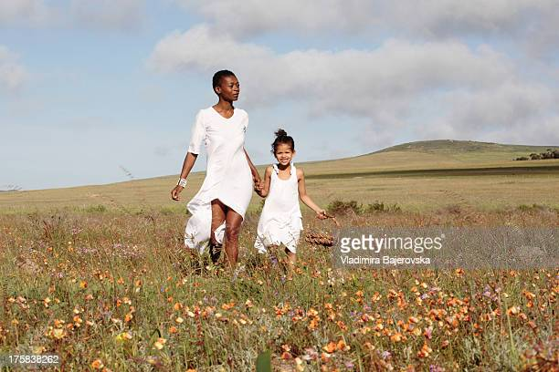 Mother and daughter among meadow, West Coast, Western Cape, South Africa