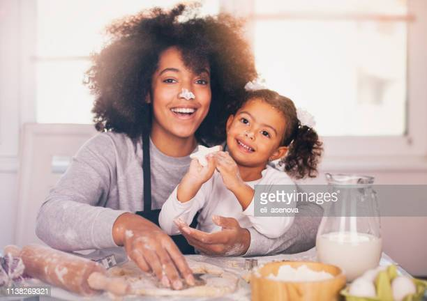 mother and daughter are baking together - massage funny stock pictures, royalty-free photos & images