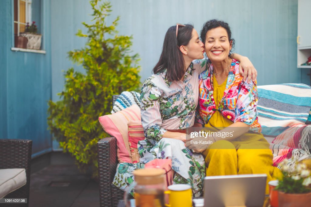 Mother and daughter are embracing each other : Stock Photo