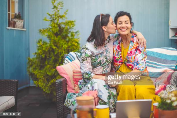 mother and daughter are embracing each other - daughter stock pictures, royalty-free photos & images