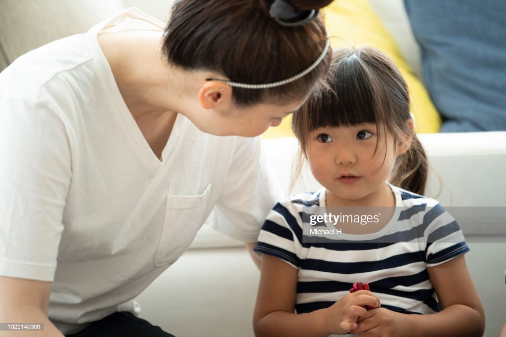 Mother and daughter are looking at each other : Stock Photo