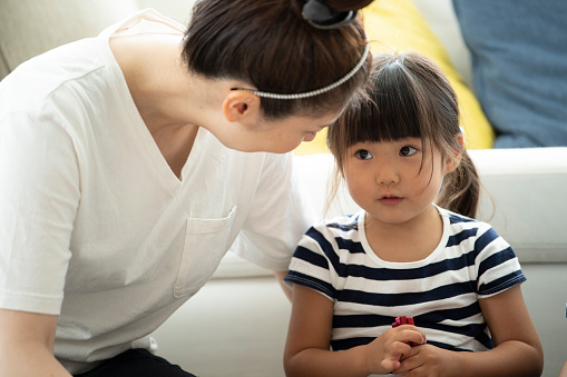 Mother and daughter are looking at each other - gettyimageskorea