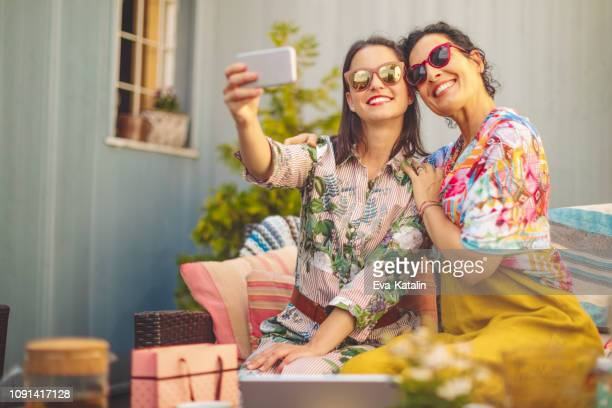 mother and daughter are taking selfies - mother's day stock pictures, royalty-free photos & images