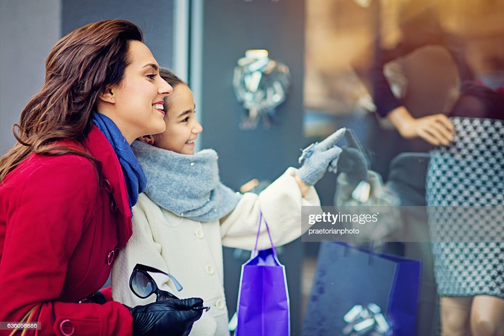 Mother and daughter are walking on the street : Stock Photo