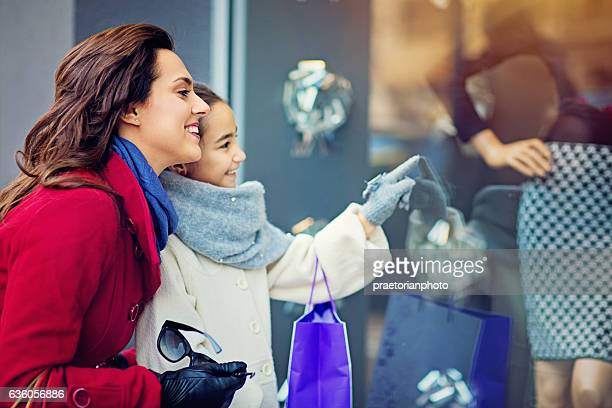 Mother and daughter are walking on the street