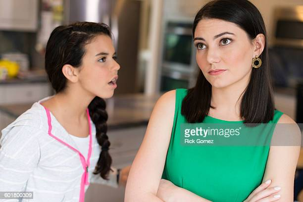 Mother and daughter arguing in kitchen