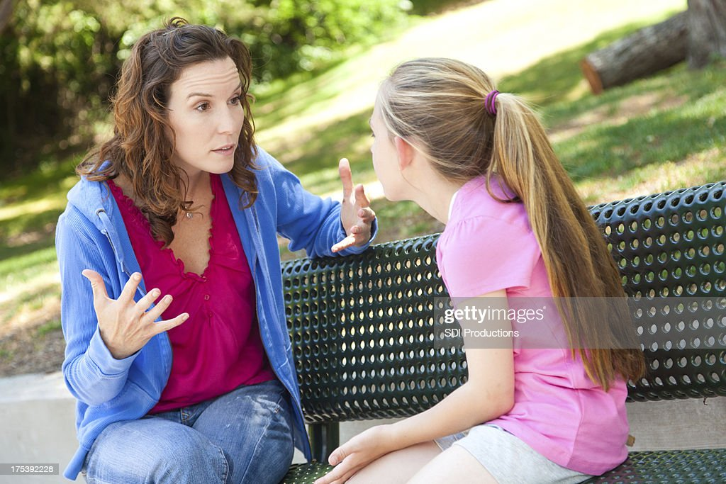 Mother and daughter arguing on a park bench : Stockfoto