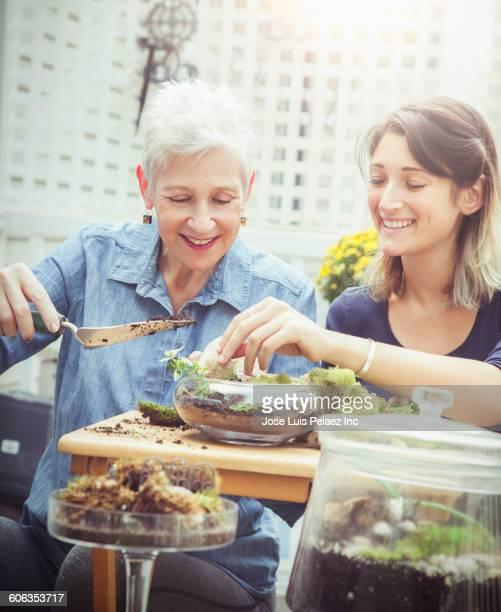 Mother and daughter arranging terrarium