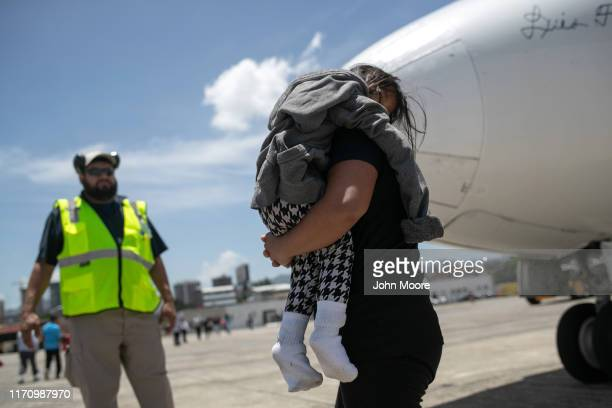 Mother and daughter arrive on an ICE deportation flight from Brownsville, Texas on August 29, 2019 to Guatemala City. Under a new policy, ICE has...