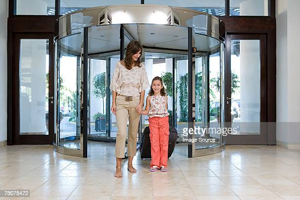 Mother and daughter arriving at hotel